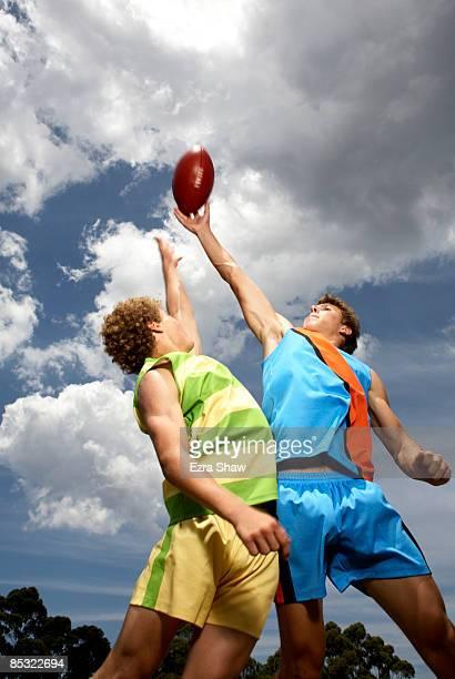 players competing for australian football - australian rules football stock-fotos und bilder