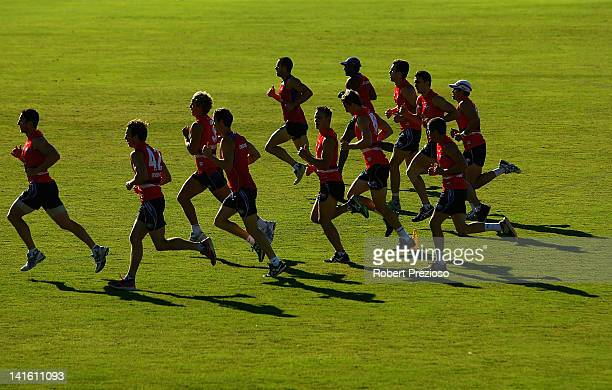 Players complete sprinting drills during the Western Bulldogs AFL training session at Whitten Oval on March 20 2012 in Melbourne Australia