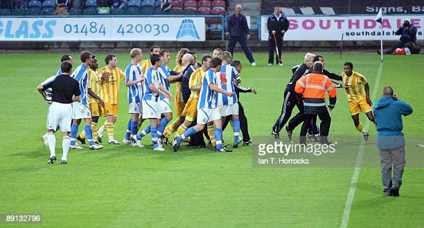 Players confront each other after the half time whistle during a preseason friendly match between Huddersfield Town and Newcastle United at the...