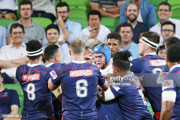 Players confront eachother after a contest during the round six Super Rugby match between the Melbourne Rebels and the Sharks at AAMI Park on March...