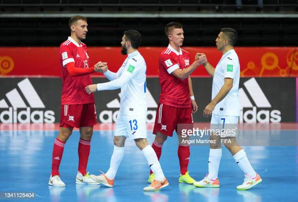 Players congratulate each other after the FIFA Futsal World Cup 2021 group B match between Guatemala and Football Union Of Russia at Kaunas Arena on...