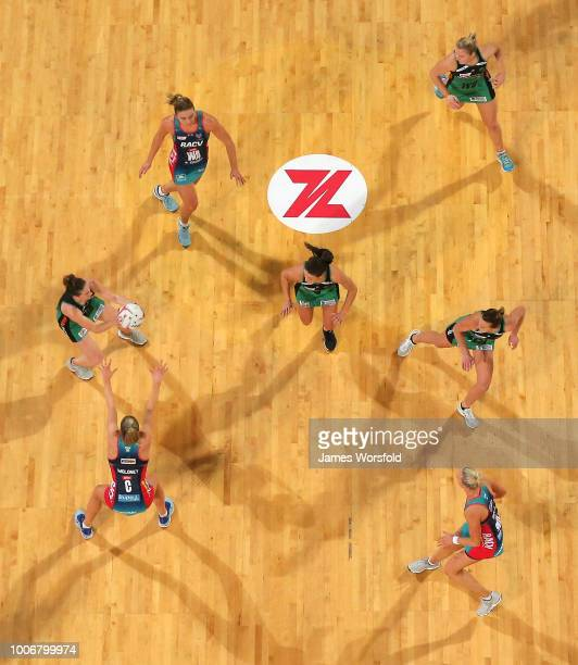 Players congregate around the centre half during the round 13 Super Netball match between the Fever and the Vixens at Perth Arena on July 28 2018 in...