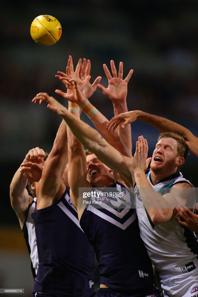 Players contest for a mark during the AFL 1st Semi Final match between the Fremantle Dockers and the Port Adelaide Power at Patersons Stadium on September 13, 2014 in Perth, Australia.