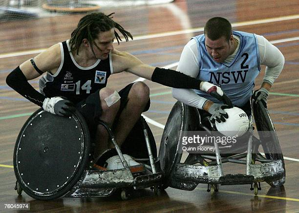 Players contest the ball during the round two National Wheelchair Rugby League match between the New South Wales Gladiators and Victoria Colopast...