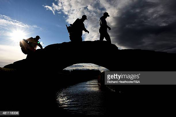 Players cross the Swilcan Bridge during the second round of the 144th Open Championship at The Old Course on July 17 2015 in St Andrews Scotland