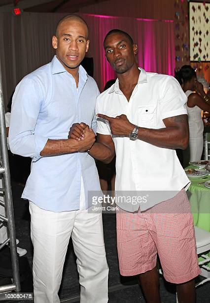 Players Dahnty Jones and Ben Gordon attend the Art For Life East Hampton 11th Annual Benefit at Russell Simmons' East Hampton Estate on July 24 2010...