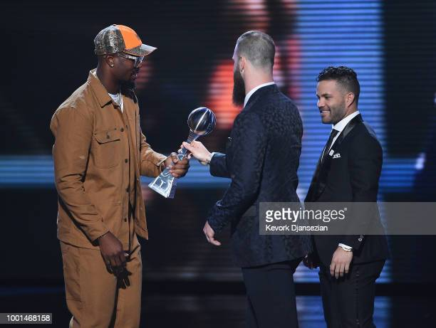 MLB players Dallas Keuchel and Jose Altuve of the Houston Astros accept the award for Best Team from NFL player Von Miller onstage at The 2018 ESPYS...