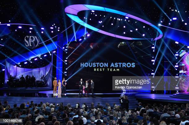 MLB players Dallas Keuchel Jose Altuve and Alex Bregman of the Houston Astros accept the award for Best Team from NFL player Von Miller and actor...