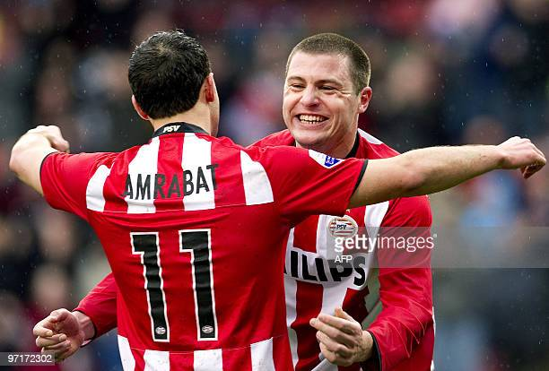 PSV players Danny Koevermans and Nordin Amrabat react after the third goal for PSV against RKC Waalwijk in Eindhoven on February 28 2010 AFP...