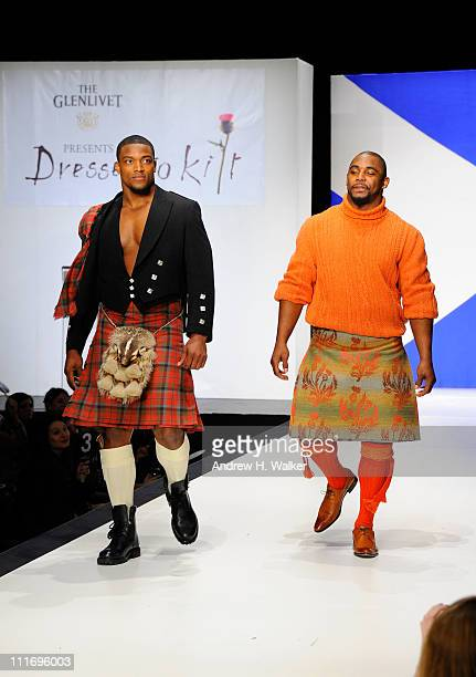 NFL players Danny Ware and Ahmad Bradshaw of the New York Giants walk the runway at the 9th Annual Dressed To Kilt charity fashion show at...