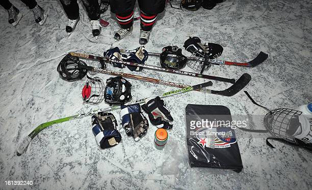 Players discard their equipment while celebrating their victory in the 2013 USA Hockey Pond Hockey National Championships on February 10 2013 in...