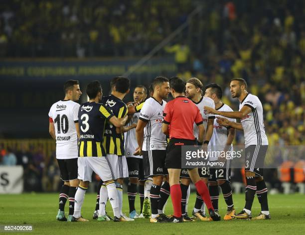 Players discuss with the referee after Quaresma of Besiktas received a red card during the Turkish Super Lig week 6 soccer match between Fenerbahce...