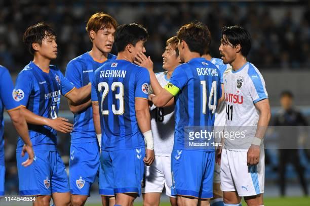 Players dispute during the AFC Champions League Group H match Kawasaki Frontale and Ulsan Hyundai at Todoroki Stadium on April 23, 2019 in Kawasaki,...