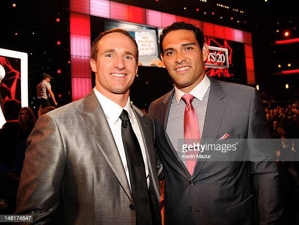 NFL players Drew Brees of the New Orleans Saints and Mark Sanchez of the New York Jets attend the 2012 ESPY Awards at Nokia Theatre LA Live on July...