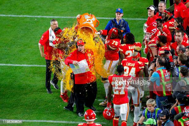 Players dunk Kansas City Chiefs head coach Andy Reid with Gatorade after they defeated the San Francisco 49ers at Super Bowl LIV at Hard Rock Stadium...