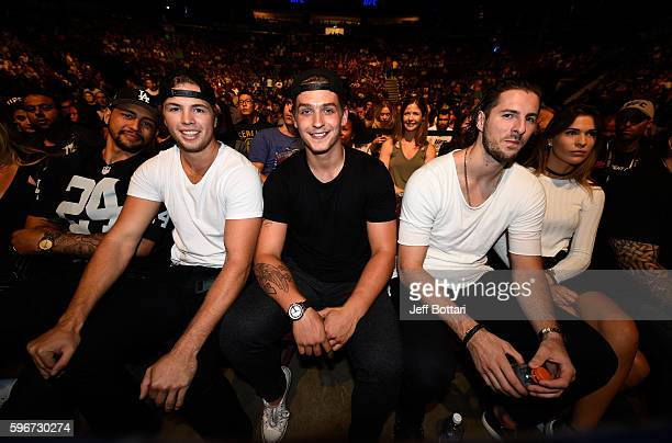 NHL players Emerson Etem Ben Hutton and Jake Virtanen of the Vancouver Canucks pose for a picture during the UFC Fight Night event at Rogers Arena on...