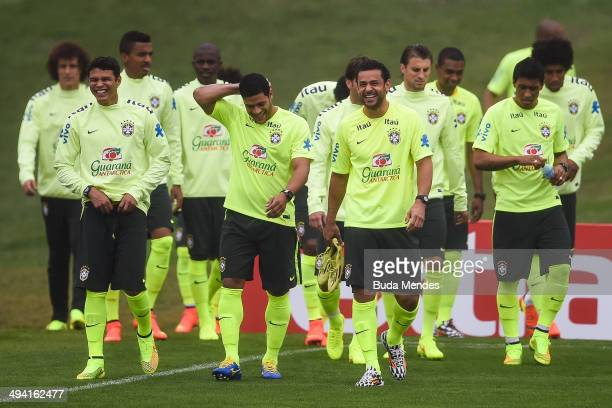 Players enter the field during a training session of the Brazilian national football team at the squad's Granja Comary training complex in...