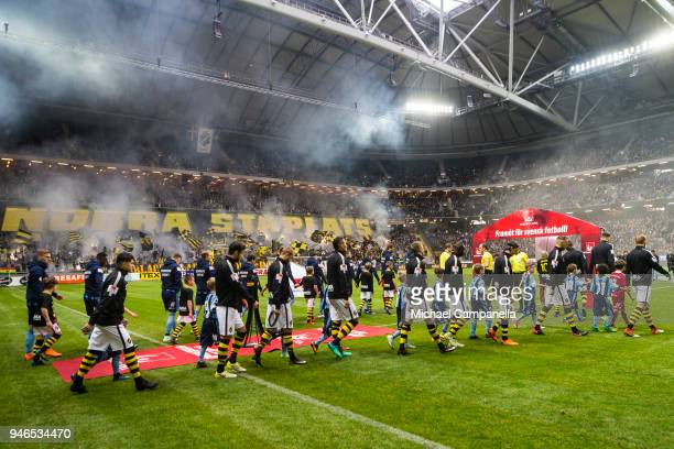 Players enter the pitch ahead of an Allsvenskan match between AIK and Djurgardens IF at Friends arena on April 15 2018 in Solna Sweden