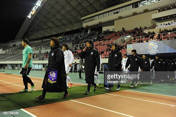 Players enter the pitch prior to the AFC Champions League Group G match between Sanfrecce Hiroshima and Bunyodkor at Hiroshima Big Arch on February...