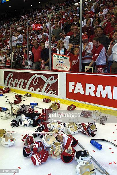 Players equipment liters the ice following an NHL Stanley Cup victory by the Detroit Red Wings over the Carolina Hurricanes on June 13 2002 at the...