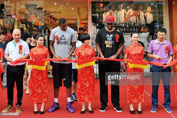 NBA players Eric Griffin of the Dallas Mavericks and Carl Landry of the Sacramento Kings attend PEAK new store opening at Guangzhou Higher Education...