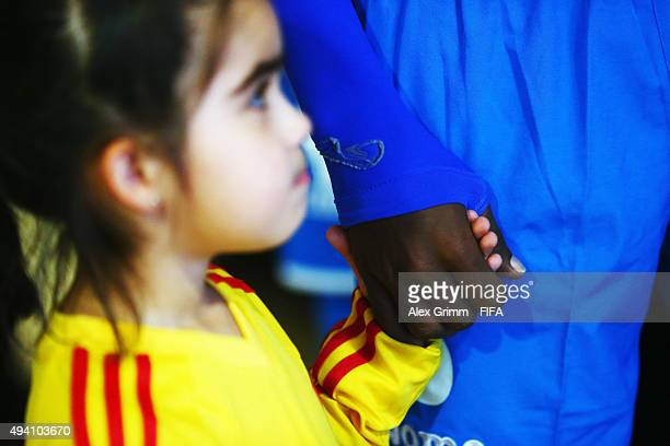 A players' escort holds the hand of team captain Dylan Andrade of Honduras in the tunnel prior to the FIFA U17 World Cup Chile 2015 Group D match...