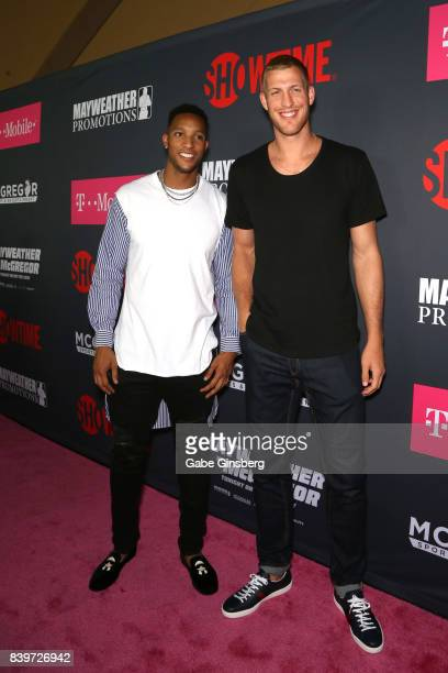 NBA players Evan Turner and Mason Plumlee arrive on TMobile's magenta carpet duirng the Showtime WME IME and Mayweather Promotions VIP PreFight Party...