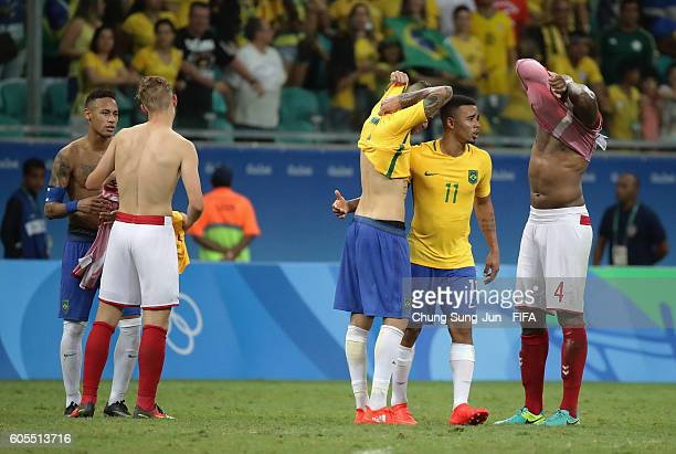 Players exchange their jersey after the Men's Football match between Denmark and Brazil on Day 5 of the Rio 2016 Olympic Games at Arena Fonte Nova on...