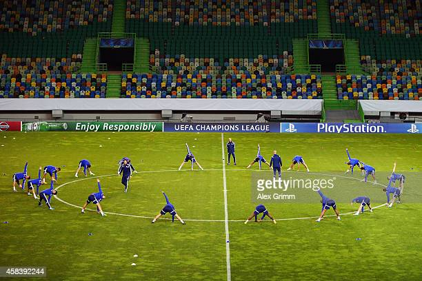 Players exercise during a FC Schalke 04 training session ahead of their UEFA Champions League Group G match against Sporting Club de Portugal at...