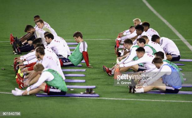 Players exercise with Pilates coach Peter Schloesser during a training session on day 4 of the FC Bayern Muenchen training camp at ASPIRE Academy for...