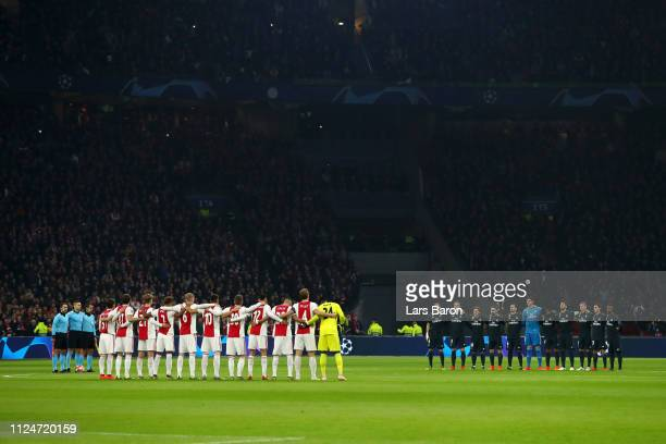 Players fans and officals pay tribute to Emiliano Sala and Gordan Banks prior to the UEFA Champions League Round of 16 First Leg match between Ajax...