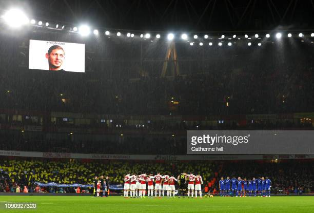 Players fans and officials take part in a minute of silence in tribute to Emiliano Sala prior to the Premier League match between Arsenal FC and...