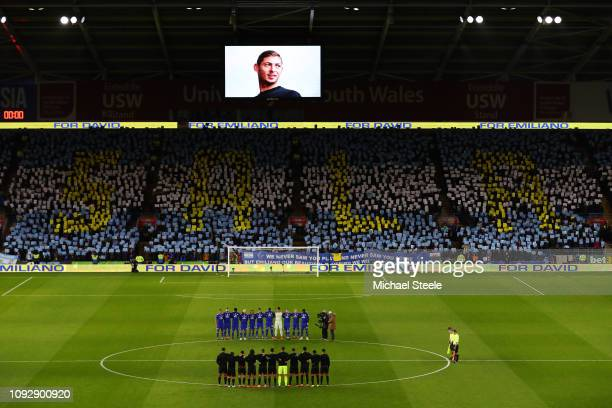 Players fans and officials take part in a minute of silence in tribute to Emiliano Sala prior to the Premier League match between Cardiff City and...