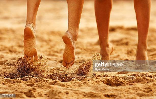 Players feet kick up sand during the Womens round one Beach Volleyball match between Kazakhstan and Malaysia during day two of the 15th Asian Games...