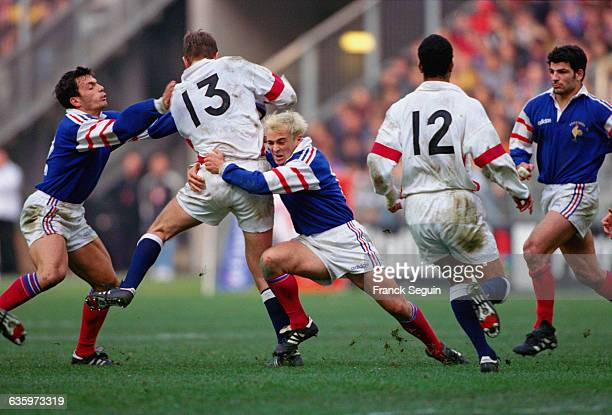 Players fight for the ball during a rugby match in which France beat England by 24 points to 17