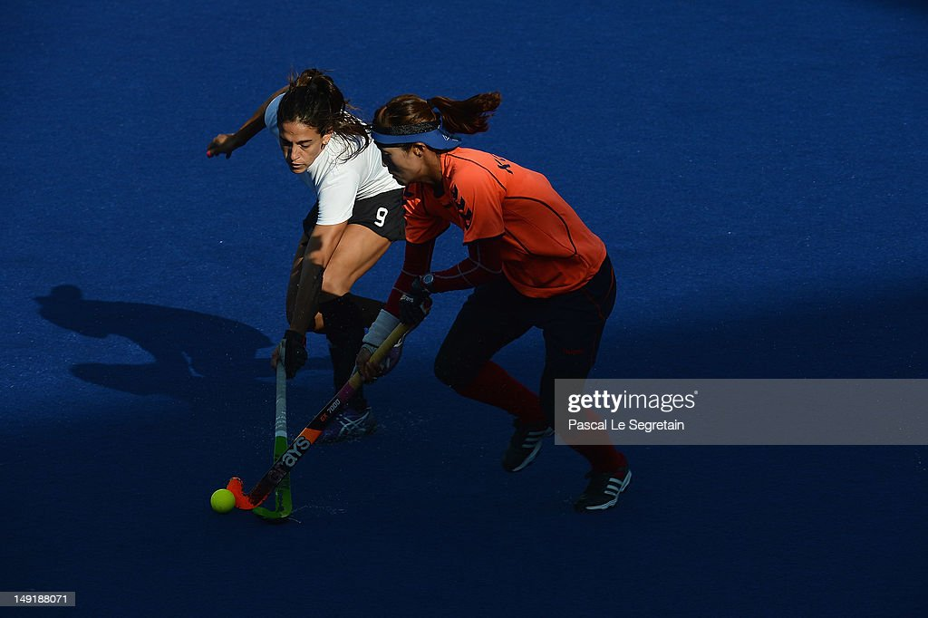 Players fight for the ball during a training hockey women match between Argentina and Korea on July 24, 2012 in London, England.