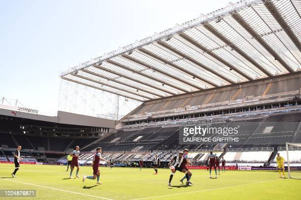 Players fight for the ball during the English Premier League football match between Newcastle United and West Ham United at St James' Park in...