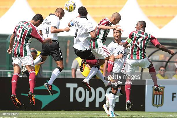 Players fight for the ball during the final match of the Copa de Juniores 2012 at the Pacaembu stadium on January 25 2012 in Sao Paulo Brazil