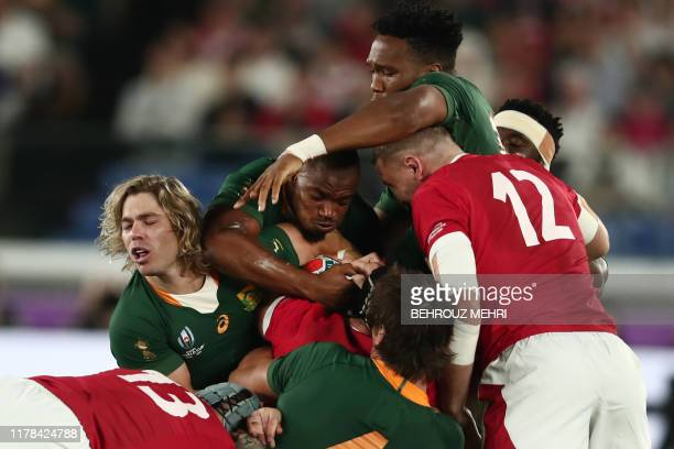Players fight for the ball during the Japan 2019 Rugby World Cup semifinal match between Wales and South Africa at the International Stadium Yokohama...