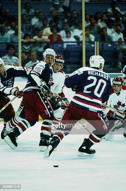 Players fight for the puck in a hockey game between the United States and Canada in the 1990 Goodwill Games Tacoma Dome Tacoma Washington USA