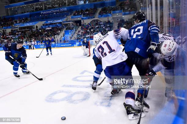 Players fight for the puck in the men's preliminary round ice hockey match between Finland and Norway during the Pyeongchang 2018 Winter Olympic...