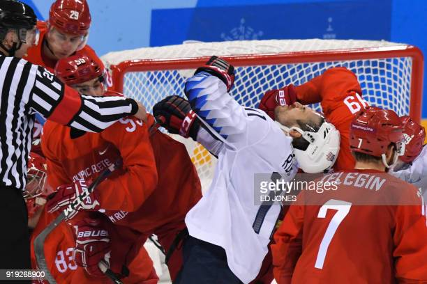 TOPSHOT Players fight in the men's ice hockey preliminary round group B game between the Olympic Athletes from Russia and the United States during...