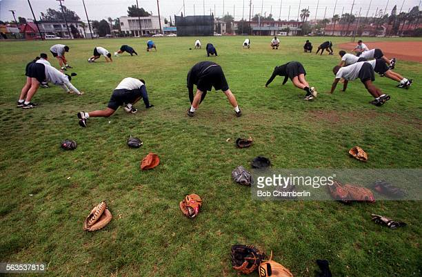 Players for Long Beach's new minor league baseball team the Breakers do a light workout in the morning before boarding the team bus for a trip to...