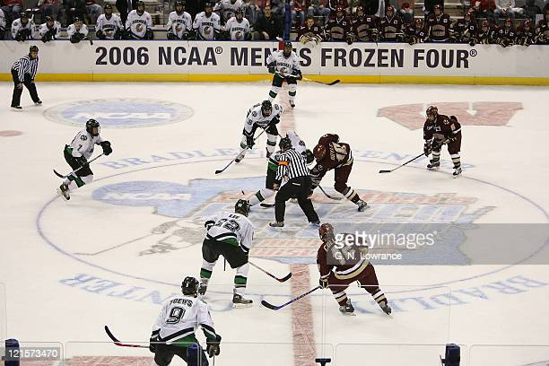 Players for North Dakota and Boston College prepare for a faceoff during 3rdperiod action in the semifinals of the NCAA frozen four at the Bradley...