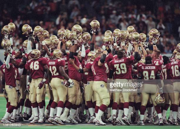 Players for the Florida State Seminoles raise their helmets in celebration after winning the NCAA Nokia Sugar Bowl Championship Series National...