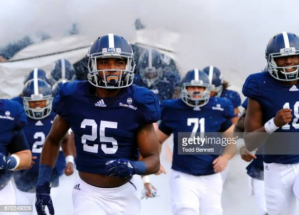 Players for the Georgia Southern Eagles take the field before their game against the Georgia State Panthers at Paulson Stadium on November 4 2017 in...
