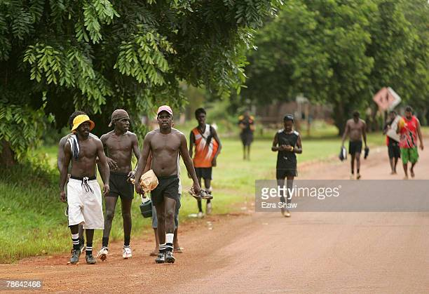 Players for the Muluwurri Magpies walk back to their boat that will take them back to Melville Island after playing the Tapalinga Super Stars on...
