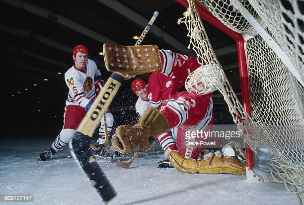 Players for the Streatham Redskins Ice Hockey team in goalmouth net action on 1 January 1985 at the Streatham Ice and Leisure Centre London Great...
