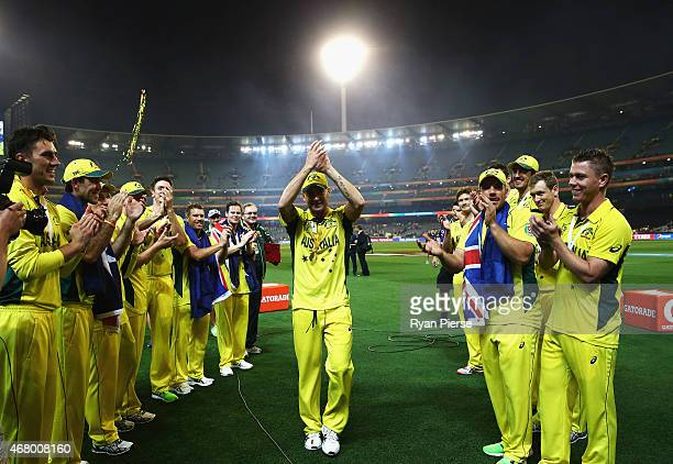 Players form a guard of honour for Michael Clarke of Australia as he leaves the field during the 2015 ICC Cricket World Cup final match between...
