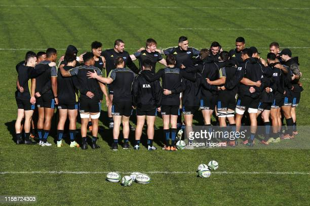 Players form a huddle during a Hurricanes Super Rugby captain's run at Rugby League Park on June 28, 2019 in Wellington, New Zealand.